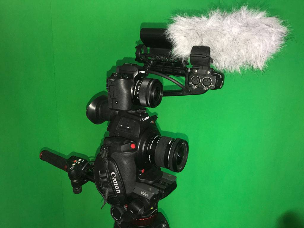 canon video camera with canon dslr mounted on top